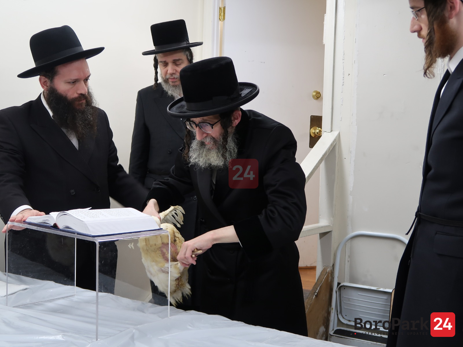 Rebbes and rabbanim perform the minhag of kapparos around Boro Park in the early morning hours of Erev Yom Kippur.