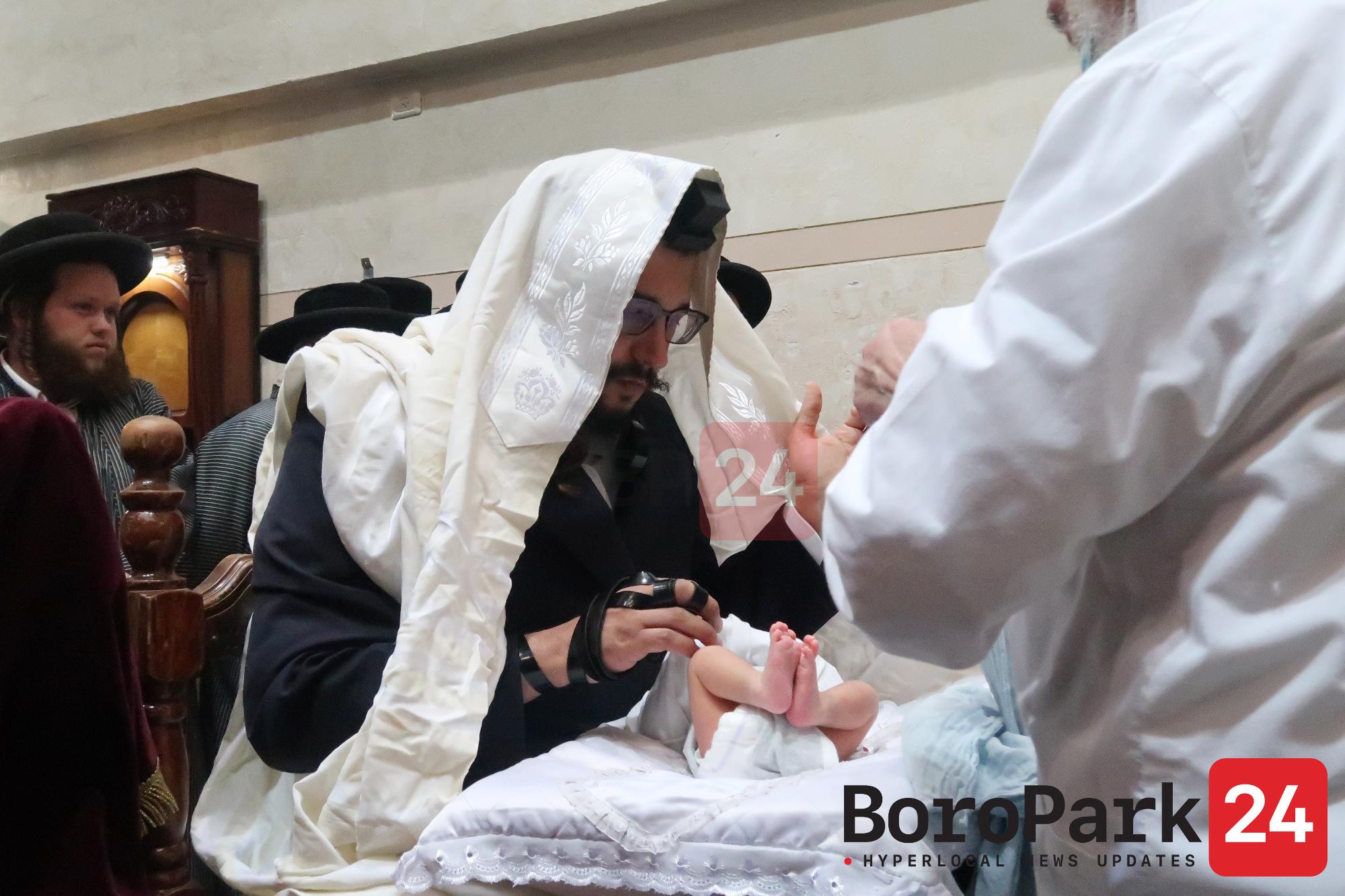 Toldos Aharon Rebbe and HaRav Shlomo Yehuda known as the Yenuka Share a Warm Conversation at a Bris